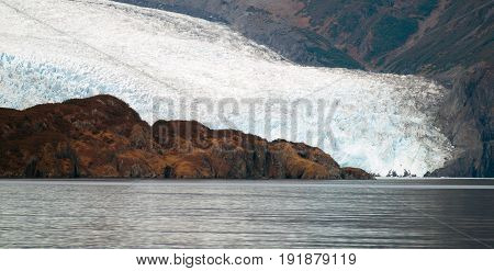 Glacier ice takes on a blue color unless glacial debris covers it