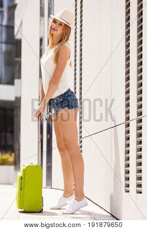 Attractive Woman With Suitcase Walking After Arrival