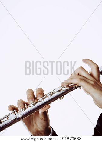 Male Flutist Plays Flute