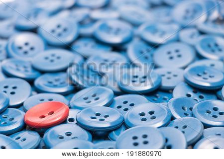 The one red button on a heap of blue buttons left based