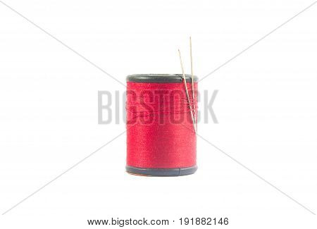 Reel or spool of red sewing thread isolated on white. background