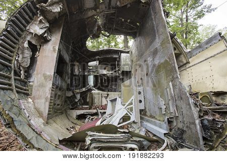 Inside of cockpit of airplane wreckage in junkyard.