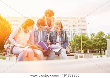 Group of friends studying together in university campus poster