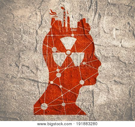 Head with factory for brain. Heavy industry and atom energy. Nuclear danger symbol. Concrete grunge texture