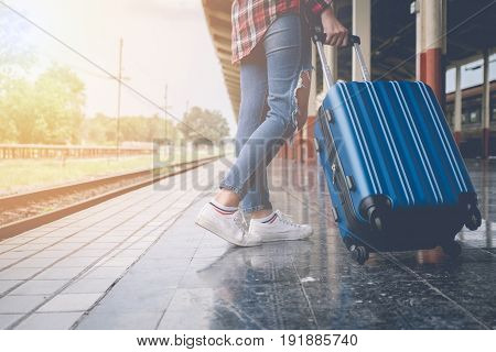 Traveler Girl With A Luggage Waiting For Train On The Station. Outdoor Adventure Travel By Train Con