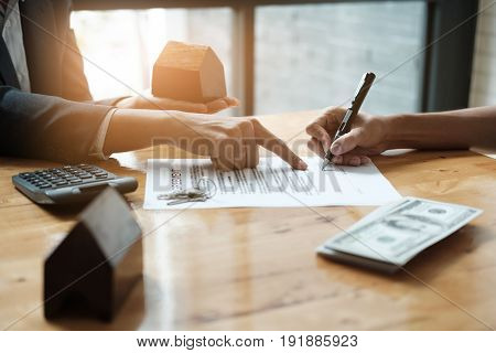 Businessman And Estate Agent Signing A Document For House Deal, Vintage Filter Effect