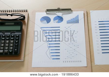 Checking Financial Reports Paperwork And Business  Teamwork On Table Calculating Or Checking Balance
