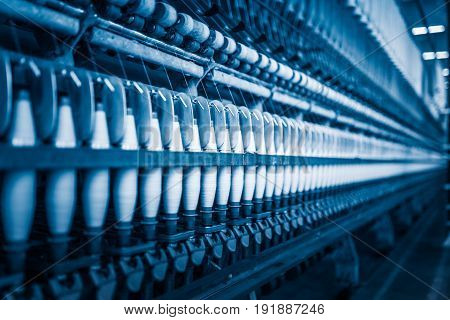 Thread making machine inside cotton millindustry concepts.
