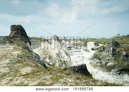 A Panoramic View of Limestone Boulders and Green Pastures Hill, Jaddih Jeddih Limestone Hill in Madura Island, Indonesia