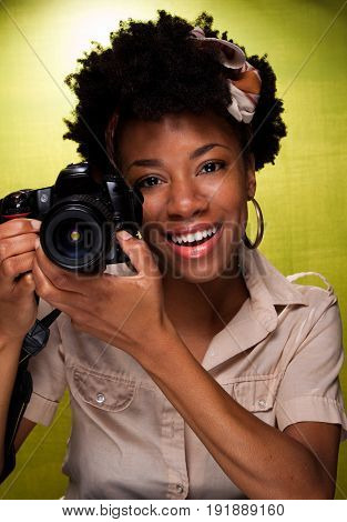 African American woman smiling and taking photos.