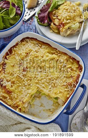 Chicken leek lasagne with pine nuts and salad