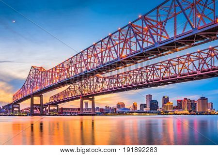 New Orleans, Louisiana, USA at Crescent City Connection Bridge over the Mississippi River.