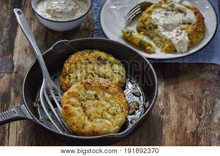 Haddock cabbage potato cakes with mustard dip