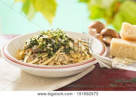 Mushroom artichoke linguini with thyme and parmesan