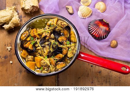 Seafood sweet potato soup on wooden background