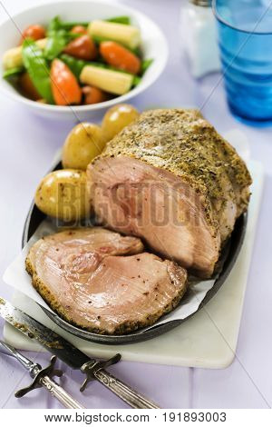 Mustard sage loin pork with baby potatoes and vegetables