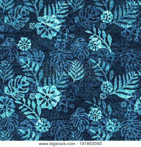 Vector denim exotic leaf seamless pattern. Faded jeans background with tropical plants. Blue jeans cloth background.