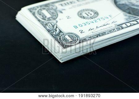 US dollars banknote stack on black background