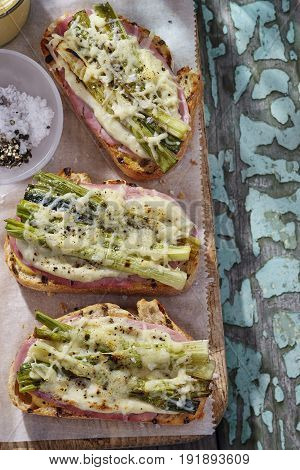Croque monsieur sandwiches with ham and roasted scallions