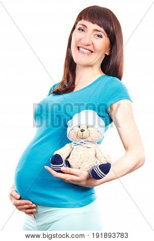 Smiling Pregnant Woman Holding Fluffy Teddy Bear With Cap For Kids, Expecting For Newborn