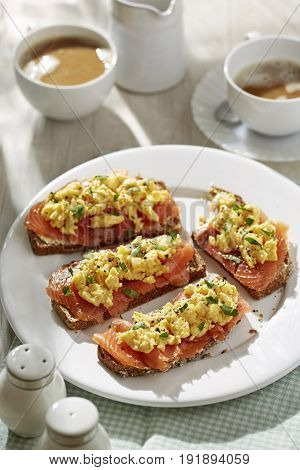 Brown soda bread with scrambled eggs and salmon