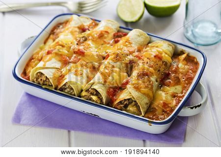 Spicy beef enchilada with cheddar and jalapeños
