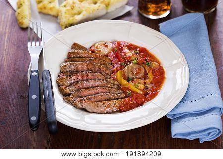 Sirloin steak with pizzaiola sauce and garlic bread
