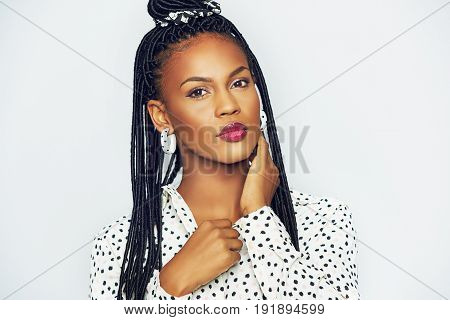 Black Woman With Traditional Bunches Touching Neck