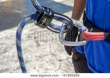Labuan,Malaysia-May 21,2017:Rock climber wearing safety harness & climbing equipment ready to climbing wall in Labuan,Malaysia.