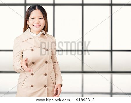Asian Woman Extending Hand To Shake