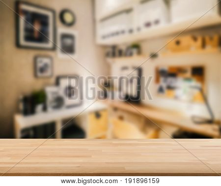 wooden counter top with workspace blurred background