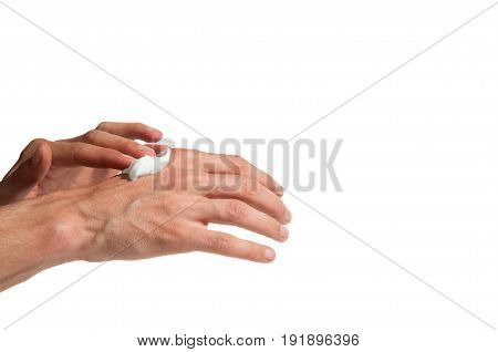 Male working hands put on a hands cream. Isolated on a white background. No retouching.