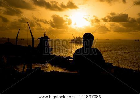 Silhouette man standing on a port in MaleMaldives