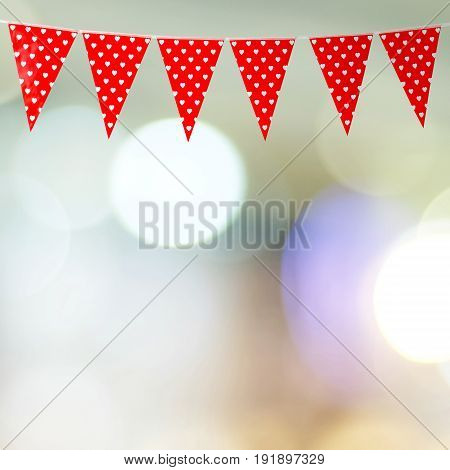 Red bunting party flag with heart shape pattern on blur abstract bokeh light background with copy space for text valentine's day concept