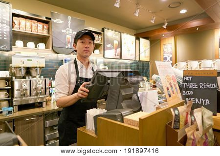 SEOUL, SOUTH KOREA - CIRCA MAY, 2017: worker at Starbucks. Starbucks Corporation is an American coffee company and coffeehouse chain.