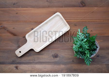 Empty wooden tray on vintage wood background food display montage kitchen ware