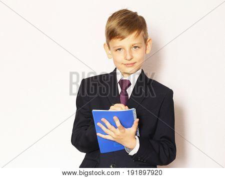 Portrait boy schoolboy in suit and tie- ready to go to school
