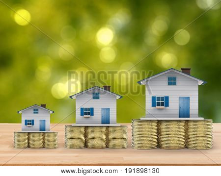 real estate investment concept with 3d rendering mock up houses and gold coins