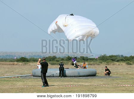 Jumper With White Open Parachute Landing On Target During Classic Accuracy Event.