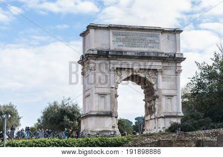 Tourists visiting the Arch of Titus on December 28 2013 in Rome, Italy