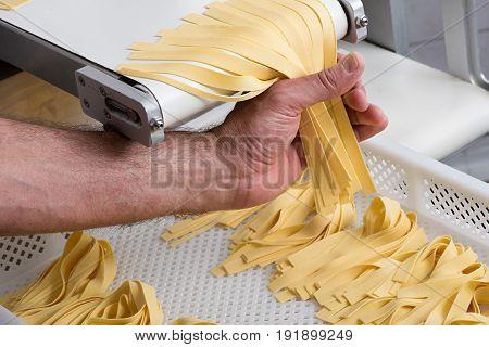 Preparing Freshly Made Tagliatelle Italian Pasta