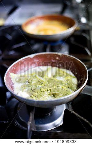 Cooked Ravioli On Burners