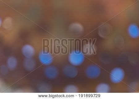 soft abstract background rusty brown with blue bokeh