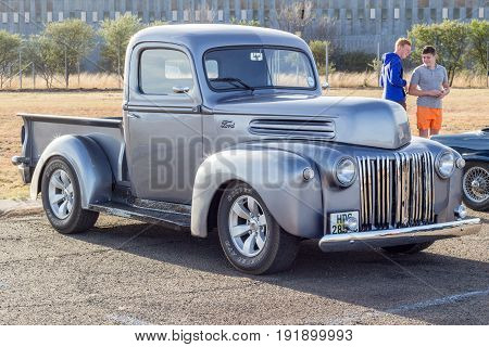 QUEENSTOWN SOUTH AFRICA - 17 June 2017: Vintage F series silver grey Ford pick up truck hot rod parked on display at public show