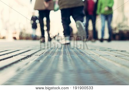 Feet of a running child. Blurred. Low point of view. Selective focus. Novi Sad, Serbia.