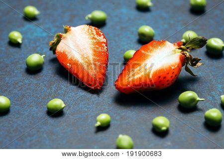 macro Strawberry amd green peas on vintage eco background. healthy eating concept. Flat lay, top view.
