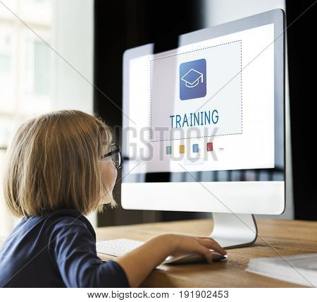 Small girl working on computer network graphic overlay