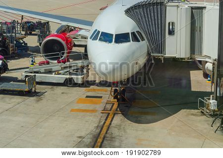 Airport of Mallorca airplane in departure area during loading and refueling ready for departure.