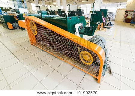 Manufacture of aluminum wire. Machine for processing wire, V-belt drive. Protective fence.