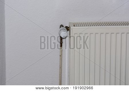 Old panel radiators in a renovated room.